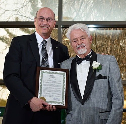 Photo of ChEMS department chair Donald Morelli (left) and alumni award winner Bruce Anderson (right)