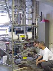 Photo of two students looking at a distillation apparatus.