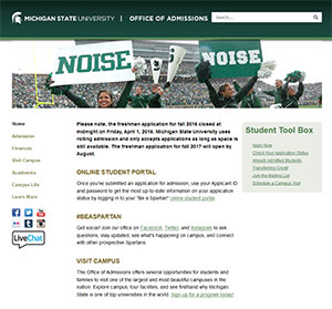"Screen shot of the MSU Office of Admissions homepage - photo of two cheerleaders at a game holding signs ""NOISE"""